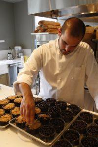 Chef Roberto Bellisimo assembling the blueberry crisps