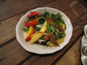 This is a fabulous local stone fruit salad with deep fried okra.