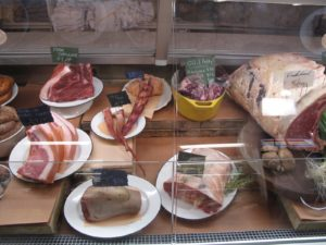 An unusual assortment of meats, such as ox tail, pig tail, beef tongue, and beef lung