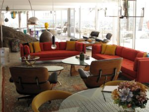 Here, mid-century furniture mingles with a giant boulder.