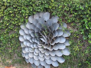 This giant metal flower, by Harry Bertoia, is one of several that adorn the garden walls.