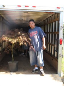 Baulilio took the lead in loading the trailer.