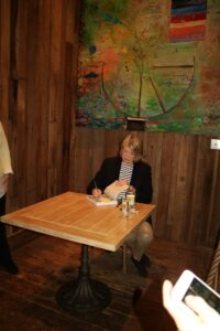"After the demo, I conducted a book signing. Here I am signing copies of ""Appetizers"", ""Clean Slate"" and ""Cooking School""."