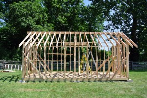 Here, much of the framework for the walls is complete including the framing for the door and window openings.