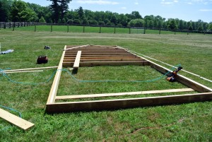 The frame was built using pressure-treated lumber. Once the outer frame was constructed, the joists were secured at 16-inch intervals.