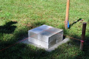 Mason's twine was also used to create straight lines as a guide for placing the concrete blocks.