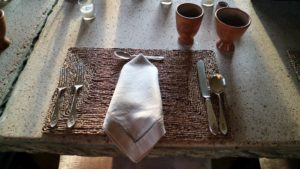 The place setting for our lobster linguine dinner was simple- grass mats, linen napkins, and Peruvian clay dishes and glasses on the dining room table, made of faux bois concrete by Carlos Cortes in San Antonio, Texas.