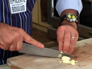 Chef Daniel explained how to cut the garlic - he keeps his fingers curled and pushes the garlic clove with his thumb. Watch how he does it on the show. Daniel added a good amount of garlic to our ratatouille.