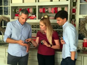 Watching our show on the iPhone are John, Shanon and Ricky Van Veen, director of global creative strategy at Facebook.
