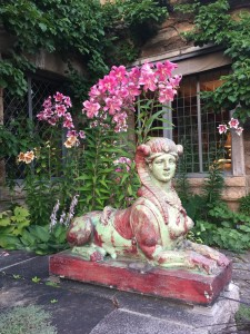 Here is one of the two glazed terra-cotta sphinxes that watch over the terrace and guard this entrance to the house. These sphinxes were designed by Emile Muller.