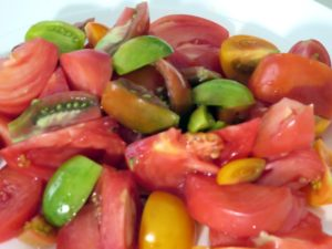 We sliced an assortment of tomatoes in different colors for our salad.