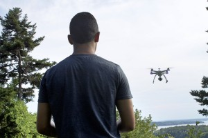 """Here is Lucas """"driving"""" his drone. Lucas works very hard to capture the many artistic views from above, and loves creating videos for business advertising and personal keepsakes."""