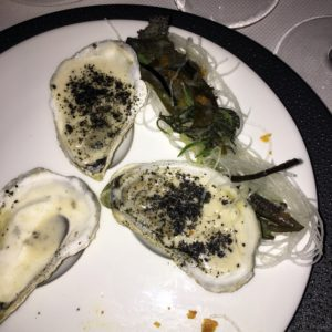 "I had these delicious oysters - what I call the new ""Oysters Rockefeller"", Daniel style. They're called HUITRE, Browne's Point Maine oysters with lemongrass-shallot veloute, Monterey seaweed and daikon salad, and salicornia - so good!"