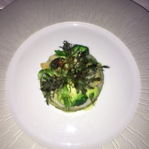 """This is Daniel's ST. JACQUES, Maine sea scallop """"rosette,"""" grilled broccolini chutney, finger lime, lovage, spicy Fidalga and pepper oil."""