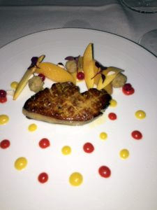 The vodka flambeed Hudson Valley FOIE GRAS is served with Scholl Orchards peaches, Indonesian pepper crumble, red currants, young Macadamia nuts and red amaranth salad.