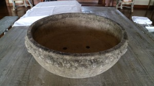 It is very large - nearly three-feet in diameter. It is on a very strong structure. The table top is made of wood-grained cement and weighs 1200-pounds!