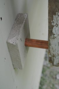 The copper adds such a nice detail. These spacers provide about three-inches in between the wall and the trellis.