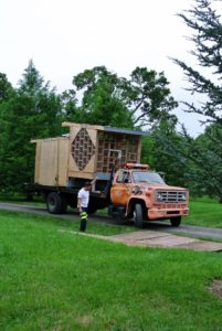 Mike guides the truck to its location not far from my chicken coops, just behind the new pumpkin patch.