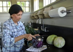 Here, Laura trims the stalk and removes the thick, fibrous outer leaves of a cabbage.