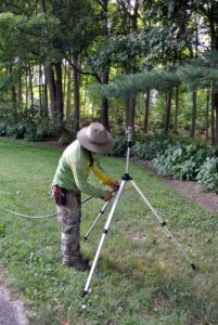 Just outside the vegetable garden Chhiring sets-up another sprinkler to water the hydrangeas. Shrubs and trees may need up to three-inches a week of water to thrive without getting water-logged.