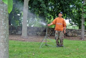 I like to use telescoping sprinklers - the height, distance and spray patterns can be adjusted to suit individual garden needs.