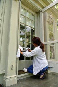 Sanu is cleaning all the glass door panes. We have a lot of events and gatherings on the calendar this fall, so everyone is busy getting the farm ready.