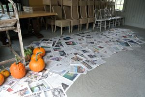 Ryan lined a section of the carriage house floor with newspaper, and categorized the harvest by type and edibility.