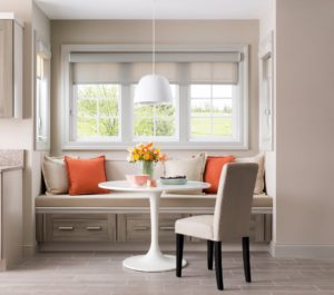 Creating a banquet seating area is a smarter use of space than a formal dining area when space is limited.