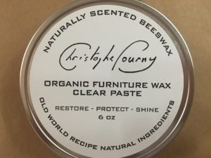 This organic furniture wax clear paste is great for any colored wood piece. It cleans and revives.