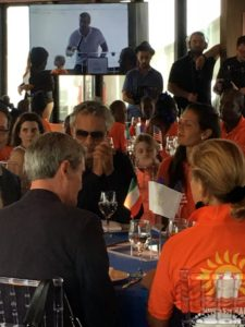 Sitting with the glasses is Italian classical crossover tenor, and singer-songwriter, Andrea Bocelli. He is the founder of the Andrea Bocelli Foundation, which focuses on empowering populations in developing countries challenged by poverty, illiteracy and illness.
