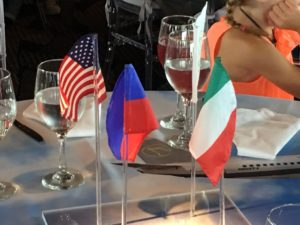 The US flag, the flag of Haiti and the Italian flag were displayed on the tables.