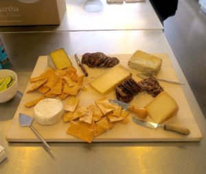 A Murray's cheese board was out for guests to snack on while cooking.