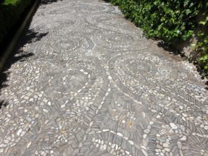 Ancient pebble mosaic floors covered the paths.