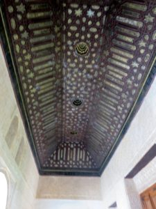 The Gilded Room, Cuarto Dorado, is so called because of the painted Mudejar style of its coffered ceiling. It as built by order of Mohammed V and belongs to the Comares Palace.