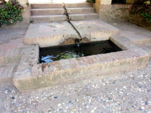 Many of the water features end in small pools around surrounded by more pebble mosaics.