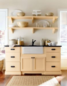 Use open shelves with corbels for displaying decorative and large dishes and bowls. The bottom, under the sink, is a toekick valance – a sink base with a toekick valance is both decorative and functional, allowing you to stand closer to the sink.