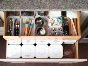 Use smaller containers in drawers to keep loose items organized and close at hand.