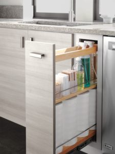 This pull-out stores often-used cleaning supplies, and is located near the sink for easy reach.