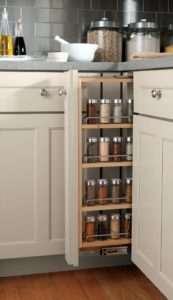 Make your kitchen work harder for you. Organizing features for every need and use in the kitchen, such as this pull-out spice rack can help keep clutter off the countertops.