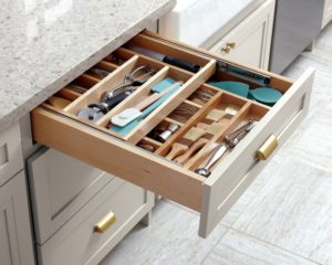 Additional drawer dividers designed in tiers will increase kitchen storage efficiency. If you are planning to renovate a kitchen, include these layered drawer features early.