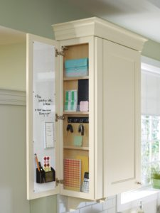 Create a message center for your family to stay on track and organized. This Martha Stewart Living Message Center cabinet is almost like a hidden door - it's the perfect place to hold keys or other odds and ends.