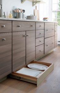 Every kitchen can be beautiful and functional no matter what the size. To make the most of your kitchen space, use every inch. Choose                                                                                     cabinets and storage solutions that have a specific use, such as this Toe Kick drawer for holding larger sized platters.