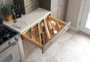 Angled drawer dividers make it easy to store longer utensils, like rolling pins, and free up valuable countertop space.