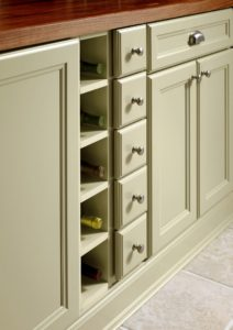Always have the right wine ready for unexpected guests with these thoughtfully-designed cubbies. Plus, the small box drawers hold accessories and are extraordinarily useful storage spaces.