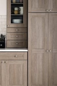 I like color palettes and designs that look and feel like natural wood, but are very durable and easy to clean - plus, it won't expand or contract with changing conditions. My Textured PureStyle cabinets are an incredibly durable laminate that resists heat, mositure and stains.