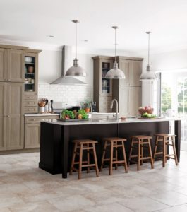 I also like mixing materials throughout the kitchen. One idea is to use two or more different kinds of finishes. Tipton, from the Martha Stewart Living™ Kitchens at The Home Depot, features a Shaker-style door design with a clean interior bevel and a chic gray-brown finish of textured PureStyle™.