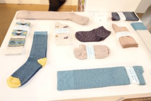 Little River Sock Mill makes women's socks in all different lengths - from footies to crew socks to over the knee.  http://littleriversockmill.com/