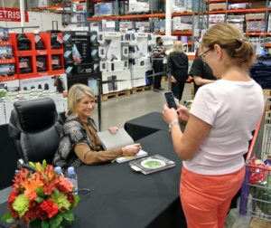Whenever I conduct book signings, I always try to stop for photos when possible - it's very important to keep the line moving, but also to take time to meet with the customers.