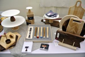 Custom shaped cutting boards and cheese boards, plus muddlers, cake stands and other unique pieces from Heirloom were very popular. http://www.amazon.com/handmade/AHeirloom-INC