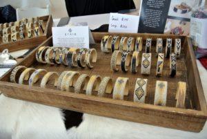 These are the striking beaded bracelets by Etkie. https://www.etkie.com/